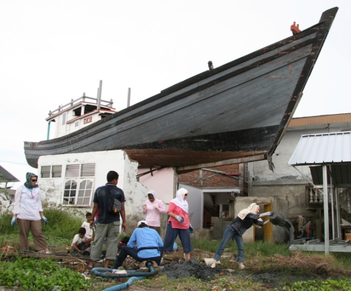 The 2004 Asian tsunami swept this 75-foot fishing boat onto a two-story home. It remains there as a museum exhibit of the power of the tsunami.